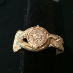 Susan Shaw equestrian plated gold bracelet .